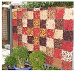 Vintage Frills ragged edge quilt where the front and back is made at the same time, quilted square by square, so no need for a backing.